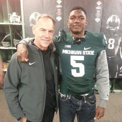 Battle Creek Central standout Brandon Randle with MSU football coach Mark Dantonio on Saturday at the Spartan spring game.