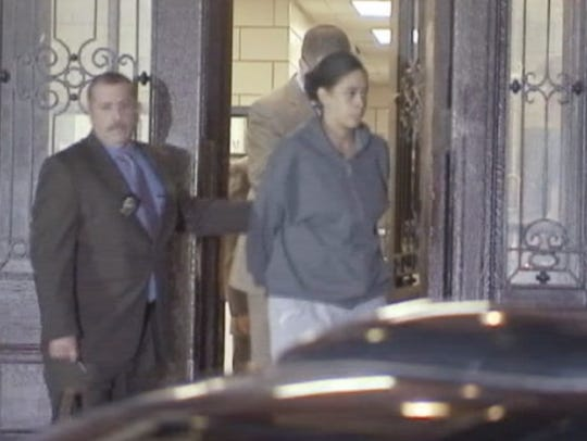 Jennifer Berry of Yonkers in police custody in the Bronx on Sept. 29, 2015. She pleaded guilty to manslaughter on Friday for killing her newborn daughter by tossing her out a seventh-floor window at her boyfriend's apartment.