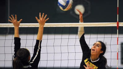 Senior Haley Qasawa connects for one of her 11 kills in the match.