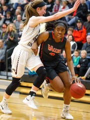 West Des Moines Valley's Zoe Young (3) drives past