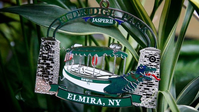 Jasper - an Eldridge Park boat ride - is the centerpiece for the 2016 Eldridge Park Carousel Preservation Society's holiday ornament. The ornament will be for sale beginning Saturday at The Christmas House located at 361 Maple Avenue in Elmira.