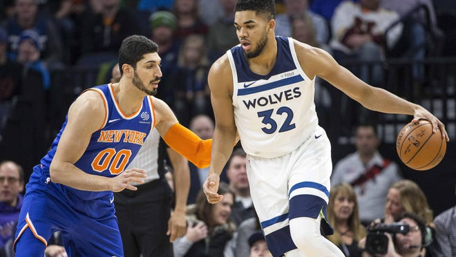 Jan 12, 2018; Minneapolis, MN, USA; Minnesota Timberwolves center Karl-Anthony Towns (32) drives to the basket against New York Knicks center Enes Kanter (00) in the first half at Target Center. Mandatory Credit: Jesse Johnson-USA TODAY Sports