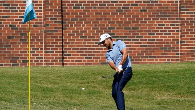 Xander Schauffele chips to the 16th green Saturday during the third round of the Charles Schwab Challenge in Fort Worth, Texas.