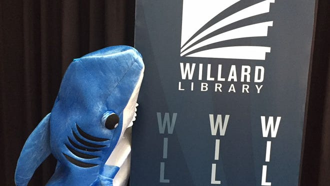 Charlie the shark takes a bite out of a Willard Library sign.