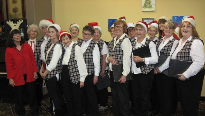 Salem Women's Chorus poses after a concert in December. The ensemble seeks new members to join their mission of bringing music to nursing homes and other facilities that serve senior citizens.