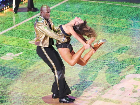 Donald Driver takes Karina Smirnoff for a spin on the