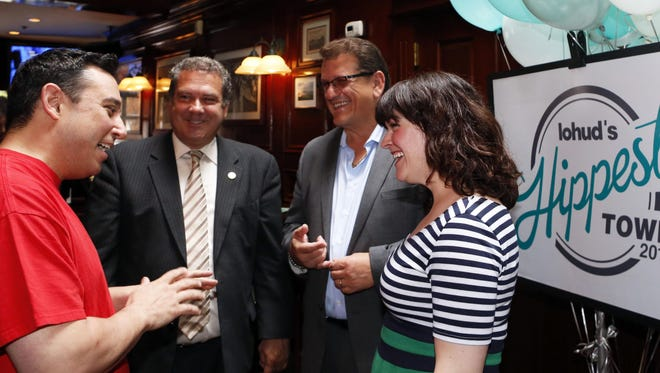 RJ Puma, owner of Anna Artuso's Pastry Shop and chairperson of McLean Avenue Merchants Association, left, chats with Mayor Mike Spano, realtor Henry Djonbalaj and lohud reporter Christine Gritmon after Yonkers was announced as lohud's hippest town at Rory Dolans Restaurant and Bar, June 1, 2015 in Yonkers.