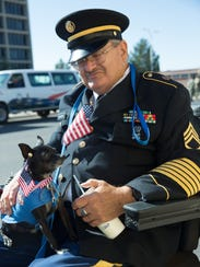 Retired Staff Sgt. Fred Schneider sits with his service