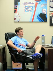 Tyler Summitt sitting in his office as the women's