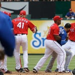 May 15, 2016: Texas Rangers second baseman Rougned Odor #12 punches Toronto Blue Jays right fielder Jose Bautista #19 in the 8th inning during an MLB game between the Toronto Blue Jays and the Texas Rangers at Globe Life Park in Arlington, Texas.