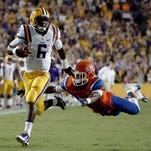 LSU quarterback Brandon Harris avoids a tackle by Sam Houston State's Mikell Everette in Baton Rouge. Harris got the better of returning starter Anthony Jennings slightly with two touchdown passes in the first scrimmage of spring practice Saturday in Tiger Stadium, according to LSU coach Les Miles.