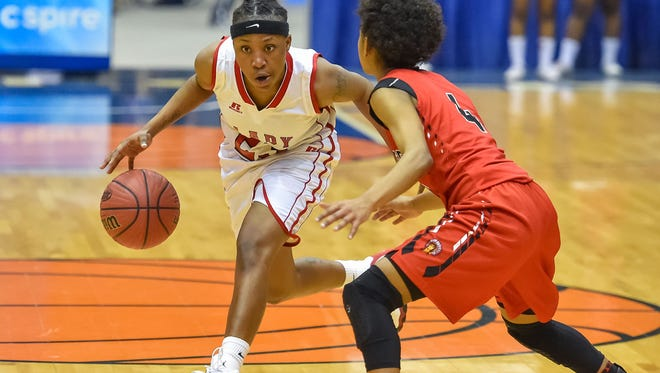 Coahoma County's Geneva Walker (23) drives against Pelahatchie's Kanosha Holyfield (4) during a MHSAA 2A quarterfinals game on Friday at Mississippi Coliseum.