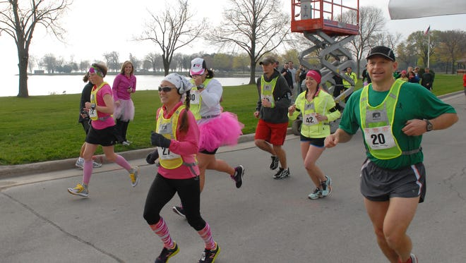 The second wave of the Run Away to the Bay relay race, a 55-mile race from Oshkosh to Green Bay, gets underway in Oshkosh's Menominee Park in this file photo from 2012. This year's event is April 22.