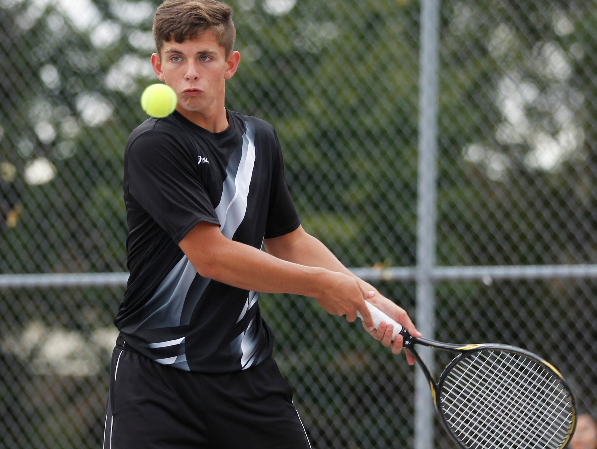 Lafayette Jeff's Jacob Isbell with a return as he and teammate Danny Isbell take on West Lafayette's Jatin Sinahal and Danial Watanabe at No. 2 doubles in the boys tennis sectional championship Friday, October 2, 2015, at Cumberland Courts in West Lafayette.