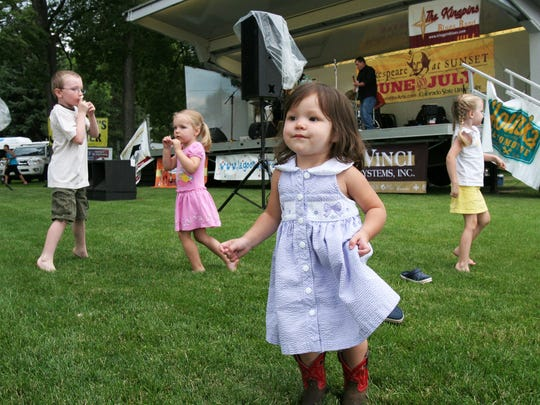 From left, Blake Rouse, 7, Emerson Rouse, 3, Brianna Mix, 2, and Ryann Rouse, 4, dance to the music of The Kingpins. The local blues band, kicked off this year's Lagoon Concert Series at CSU, Wednesday, July 14, 2010.
