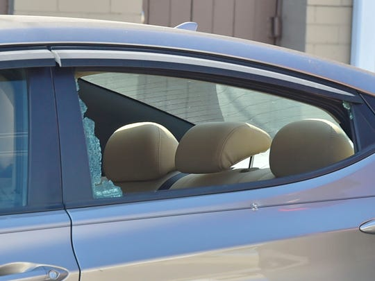 The rear driver's side door of this vehicle was shot, resulting in the window shattering. Two people were standing around this vehicle in the unit block of South Franklin Street Thursday afternoon when, according to police, Kevensly Cherilus shot at them.