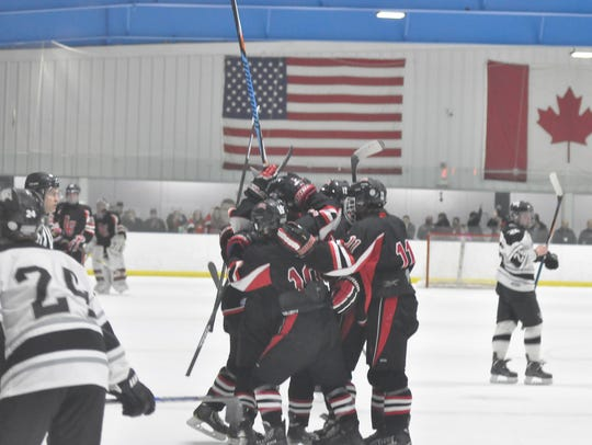 As dejected Plymouth players skate away, Livonia Churchill