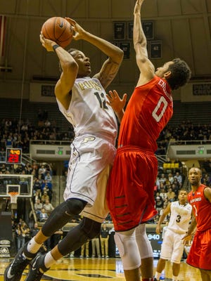Nov 14, 2014; West Lafayette, IN, USA; Purdue Boilermakers forward Vince Edwards (12) shoots the ball over Samford Bulldogs forward Nnamdi Enechionyia (0) in the first half of the game at Mackey Arena. Mandatory Credit: Trevor Ruszkowski-USA TODAY Sports