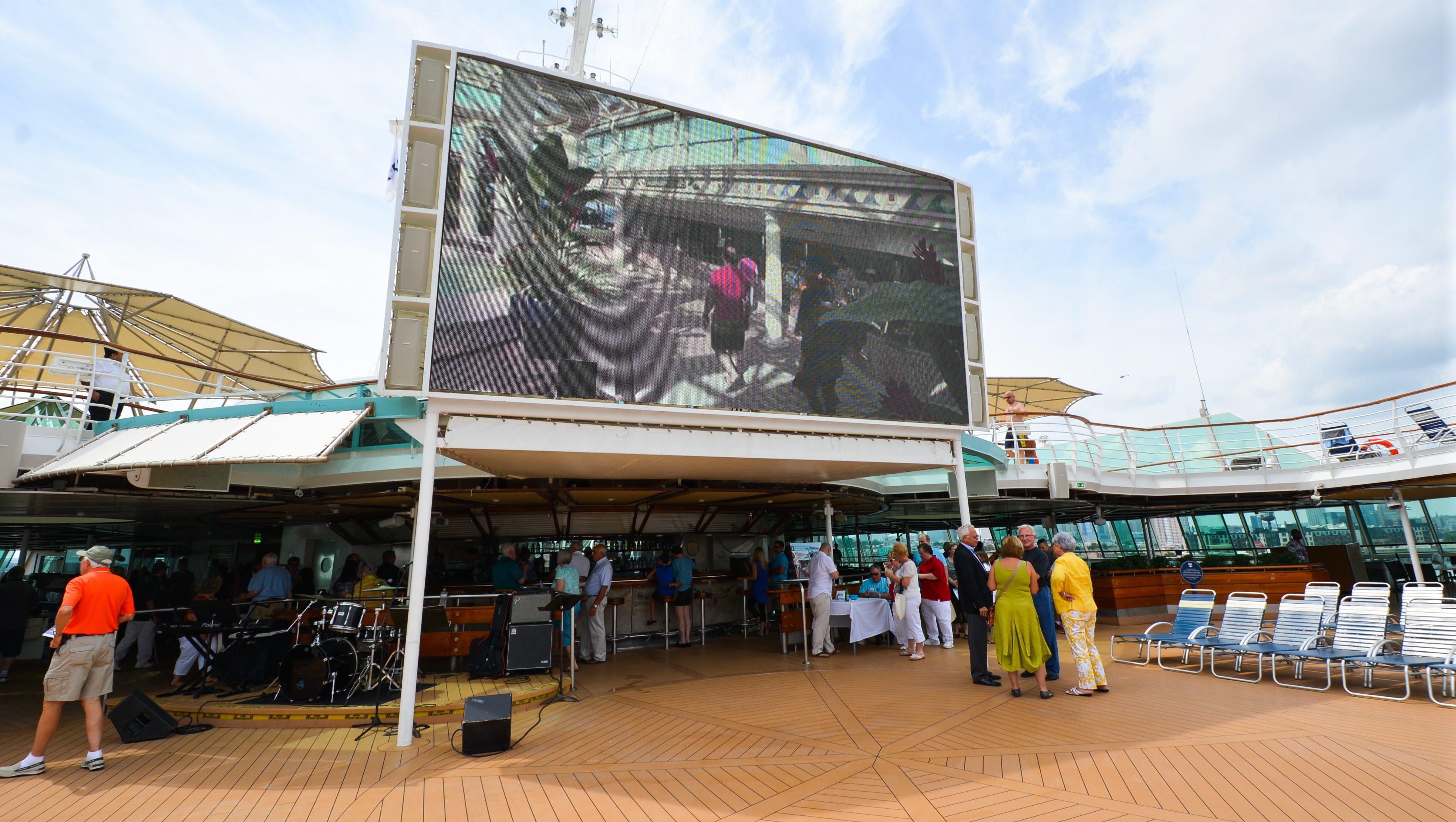 New on Grandeur of the Seas' top decks is a 220-square-foot poolside movie screen.