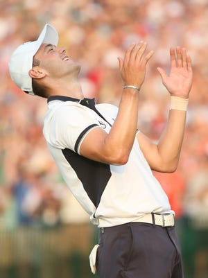 Martin Kaymer celebrates after putting out on the 18th green during the final round of the 2014 U.S. Open golf tournament at Pinehurst Resort Country Club.