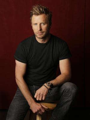 "Dierks Bentley poses for a portrait in Nashville, Tenn., to promote his latest album, ""Black."""