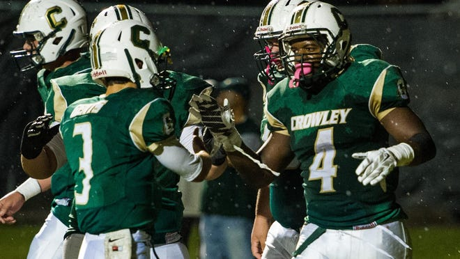 Crowley quarterback Pate Broussard (3) celebrates with running back Ty'Von Griffin (4) after Griffin scored a rushing touchdown during the Gents' 49-28 win Friday.