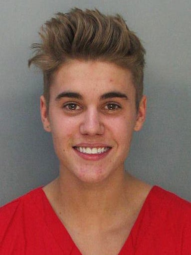 With a flash of a smile, pop star Justin Bieber joined the not-so-highly-esteemed celebrity mugshot club Thursday morning after he was arrested for allegedly drag-racing on a Miami Beach Street. We take a look at some of the more memorable celebrity mug shots over the years. (Police say Bieber has been charged with resisting arrest without violence in addition to drag racing and DUI.