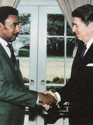 Grambling President Joseph Johnson meets President Ronald Reagan.