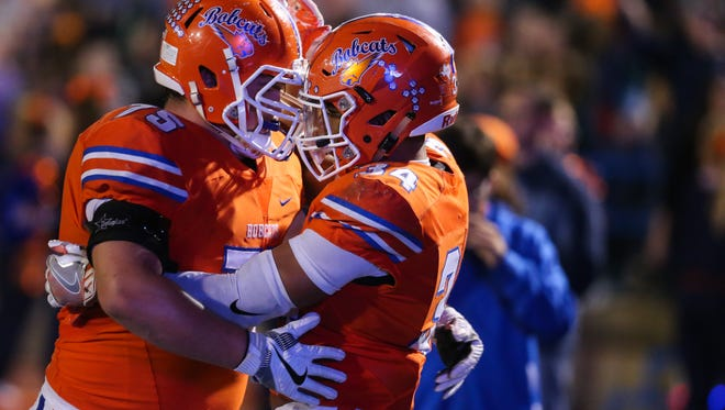San Angelo Central High School lineman Gunner Couch (left) celebrates with former Bobcats running back Daven Manning during the 2016 season. Couch is a four-year starter for the Bobcats.