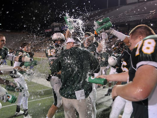 Edgewood head coach Bobby Carr gets doused during the