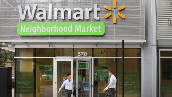Customers shop at a Walmart Neighborhood Market store this month in Chicago.