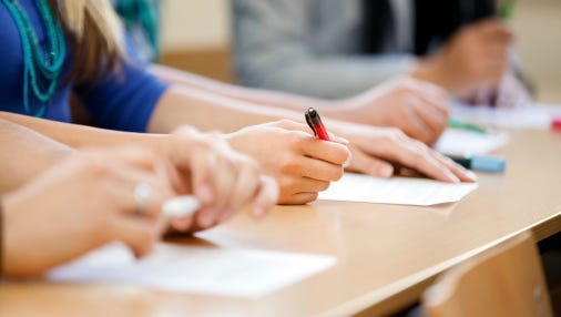 Students taking tests.