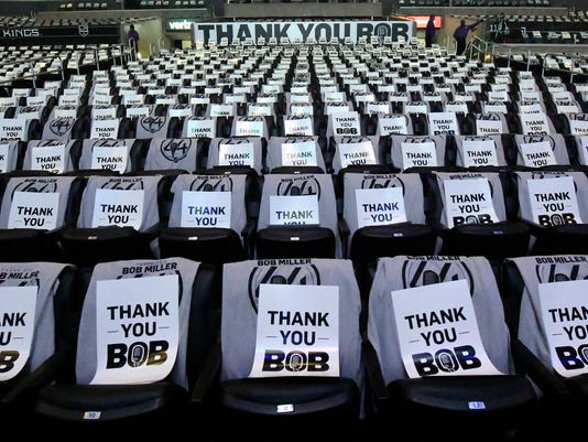 Signs sit on top of seats thanking Los Angeles Kings broadcaster Bob Miller prior to an NHL hockey game against the Chicago Blackhawks, Saturday, April 8, 2017, in Los Angeles. Miller will be announcing his last home game today before retiring. (AP Photo/Mark J. Terrill)