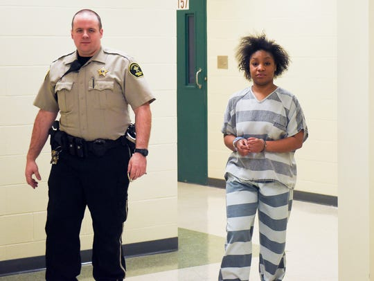Lavon Shante Jones is escorted into Minnehaha County