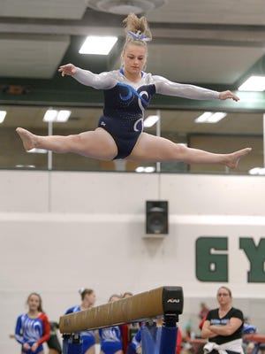 Gates-Chili's Madison Conn competes on balance beam during the Section V Gymnastics Championships & State Qualifier at SUNY Brockport on Friday. Conn placed first on beam, floor exercise and won the sectional all around, all helping Gates to win the team championship.
