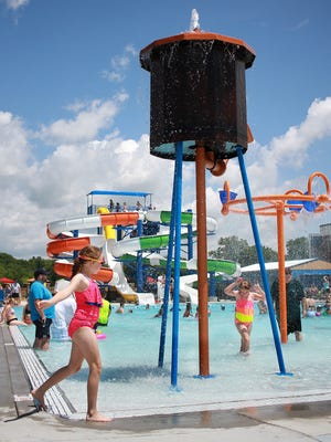 Children play at the new water park at Gallatin's new Tommy Garrott Aquatics Facility on Monday, May 29, 2017.