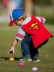 Evan Mills, 3, also known as, Superman, rescues a candy