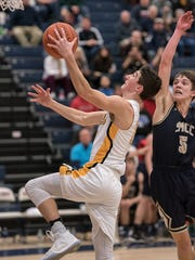 Colonel Crawford's Brody Martin takes it to the hoop.