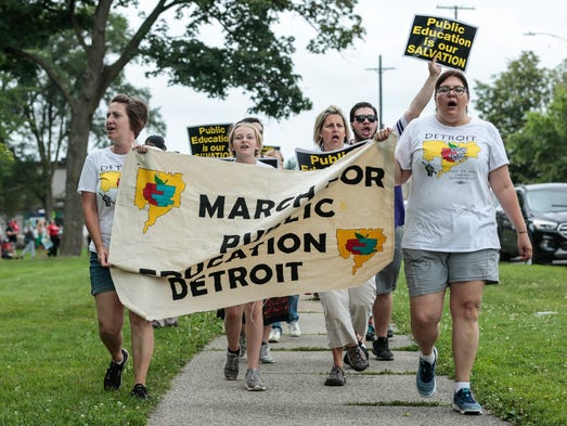 March organizers Sara Scott, far left, and Erica Foondle,