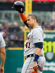 Tigers DH Victor Martinez waves to the fans after singling to left for his 2,000 career hit during the second inning Friday in Cleveland.