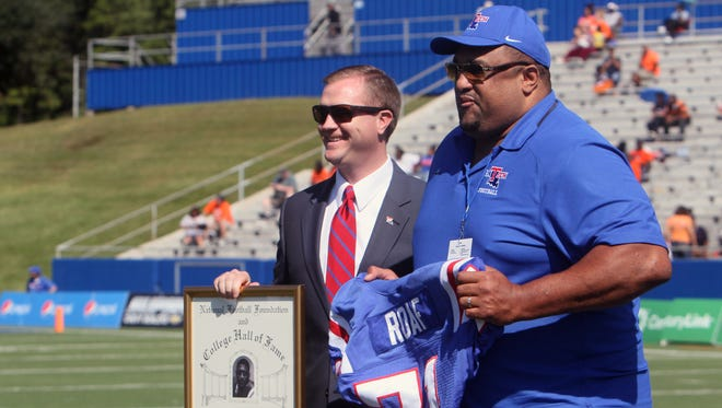 Former Louisiana Tech offensive lineman Willie Roaf (71) is honored Saturday at Joe Aillet Stadium for his induction into the National Football Foundation and College Hall of Fame.