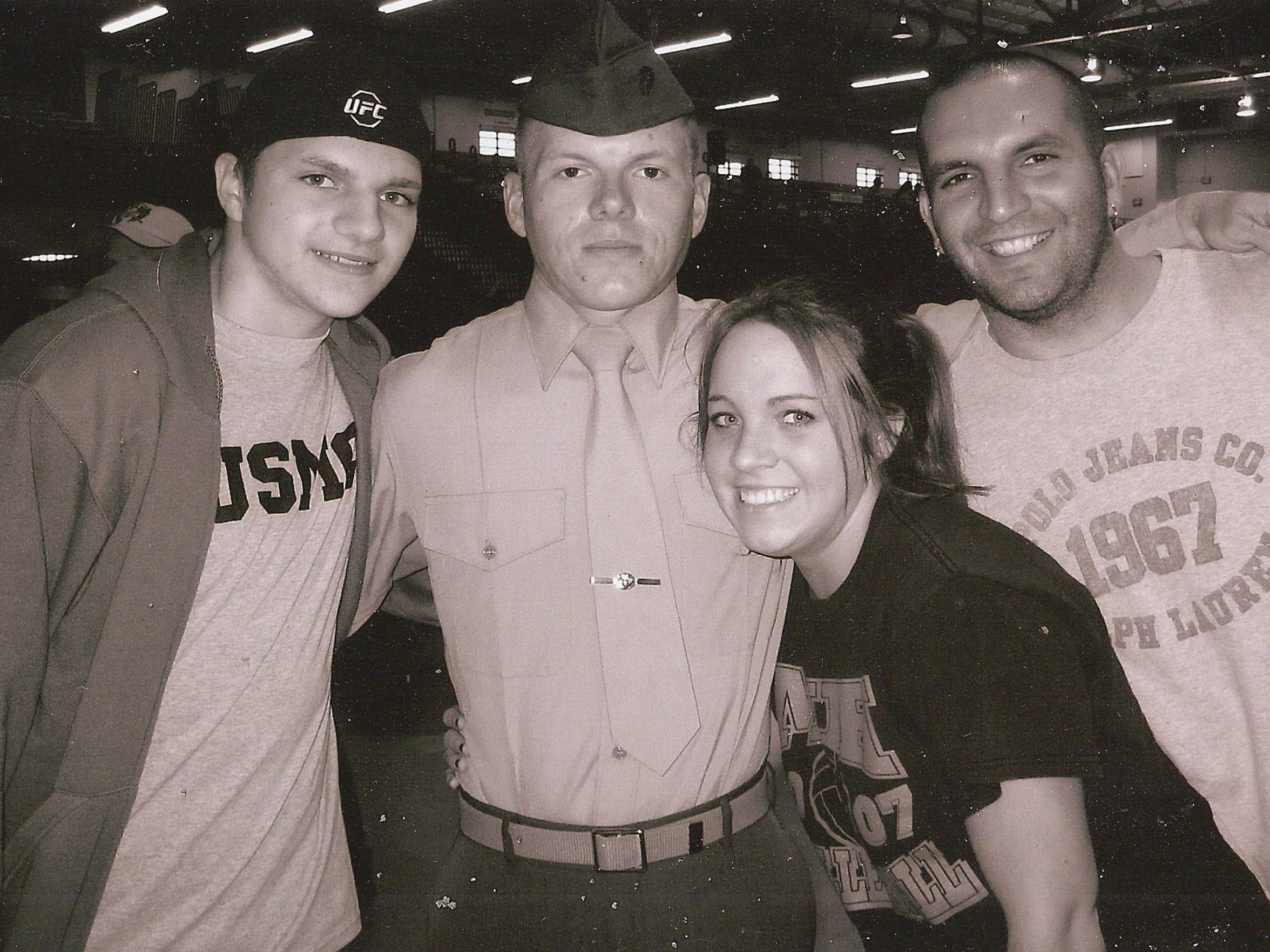 Marine veteran Jacob Faulkner, center, pictured in uniform with his family.