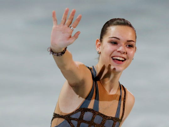 2014-02-22-adelina-sotnikova-hug-russian judge