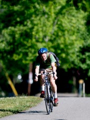 A biker rides down the Third Creek Greenway in Knoxville