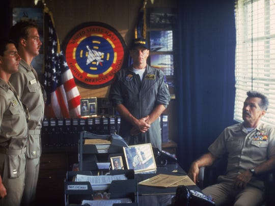 Maverick (Tom Cruise, left) and Goose (Anthony Edwards) stand at attention at Viper's desk (Tom Skerritt) in 'Top Gun.'