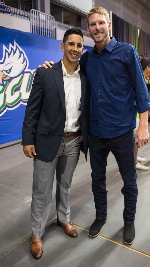 All-Star pitcher Chris Sale, right, with FGCU junior