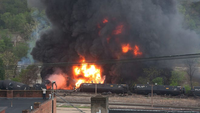 This image made available by the City of Lynchburg, shows several CSX tanker cars carrying crude oil in flames after derailing in downtown Lynchburg, Va., on April 30, 2014.