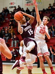 Brownwood's Adonis McCarty shoots in the lane while Sweetwater's Ky Hoover tries to block it in SHS' 41-35 win over Brownwood on Fri., Jan., 26, 2018.