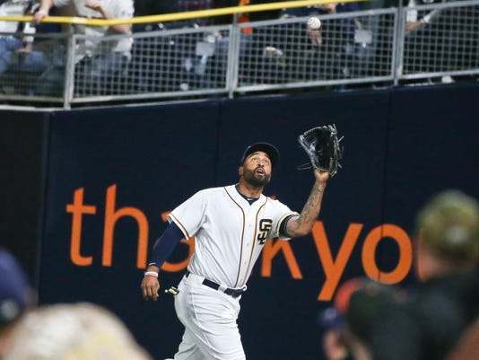 San Diego Padres right fielder Matt Kemp makes a running catch in the right field corner on a ball hit by San Francisco Giants' Matt Duffy during the fifth inning of a baseball game Tuesday, May 17, 2016, in San Diego. The Giants won 5-1. (AP Photo/Lenny Ignelzi)