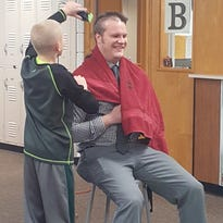 Why one principal shaved his head in front of the entire school